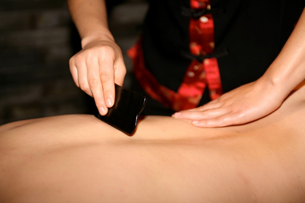 Jennifer Poplar performing Gua Sha